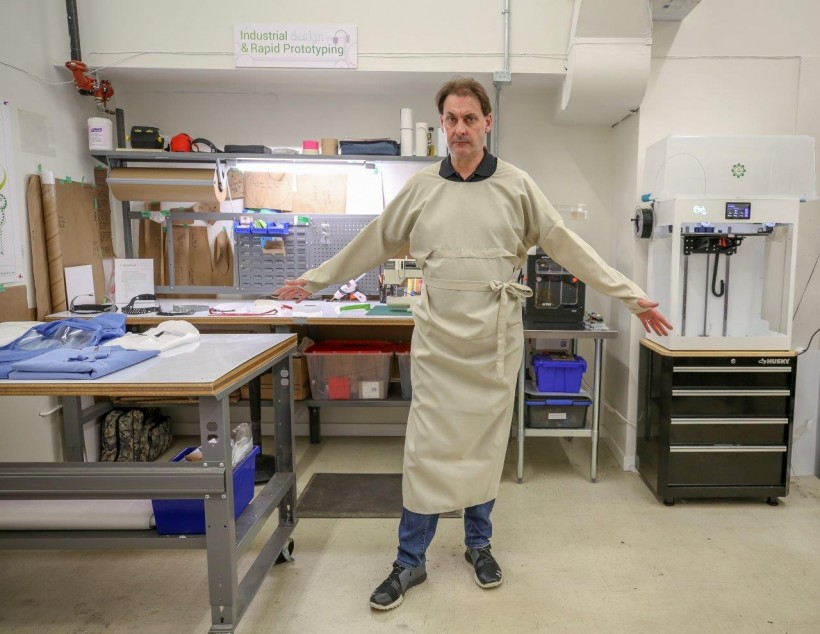 Enginuity's Alastair Trower displays the team's latest design for a reusable medical gown.