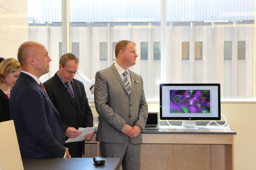 MP Andy Fillmore, left, BioNova's Scott Moffitt and Kevin Sullivan at the Appili lab opening,.
