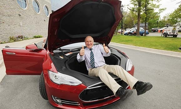 Jeff Dahn, showing off a Tesla.