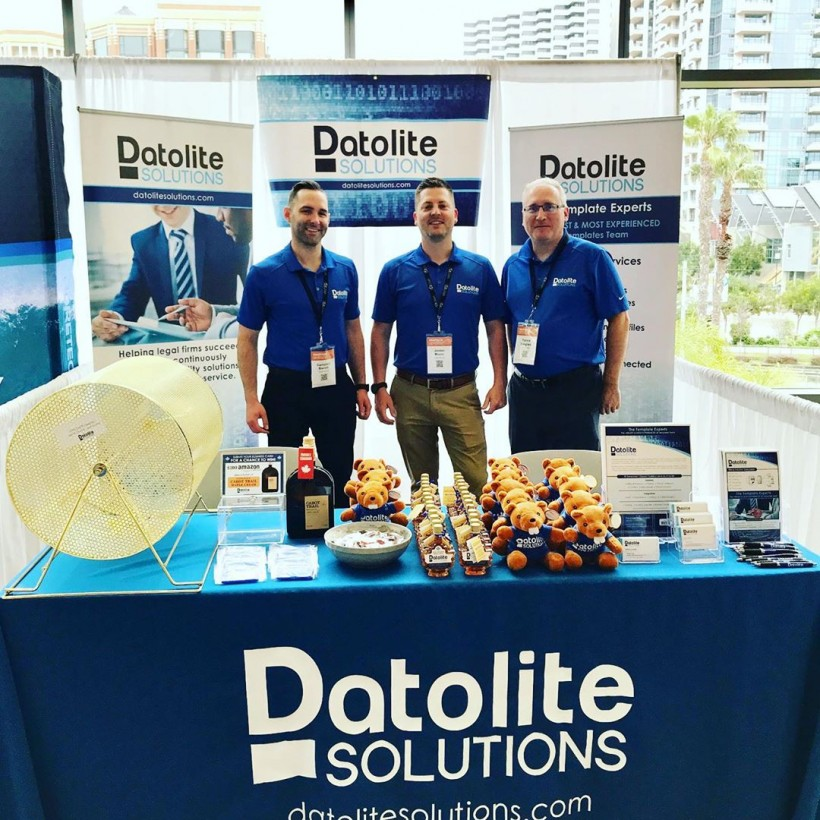 Datolite Co-Founder Campbell Barrett, left, poses with first employee Jordan Moore and Director Partick Langlais.