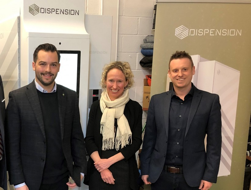 Dispension CEO Corey Yantha, left, poses with Halifax Partnership CEO Wendy Luther and Dispension COO Matthew Michaelis.