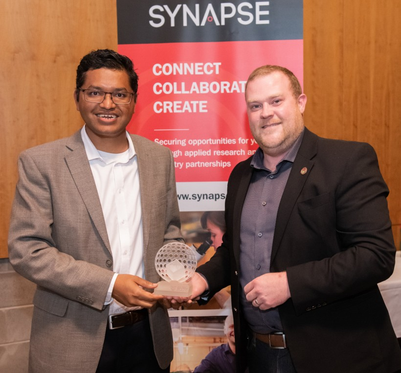 Young Innovator Award winner  Mohammed Moin, left, and Synapse CEO Dr. Justin Moores.