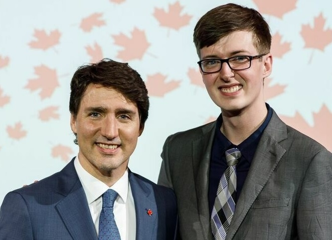 Jordan Kennie, right, with Prime Minister Justin Trudeau in Paris.